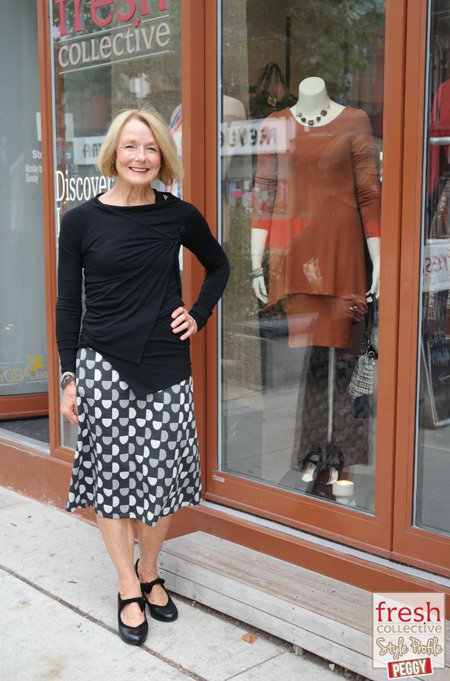 This is a great outfit for Peggy`s long and varied days.  Both pieces are stretchy and soft, allowing comfort whether traveling, in meetings or at appearances.  The silhouette suits her figure perfectly, with the diagonal lines of the wrap top and the A-line of the skirt showing off her waist nicely. (Top: Naeva - Melow $125, Skirt: Dara - Mandala $68, Shoes: Edye Lonna Heel - Hush Puppies $100)